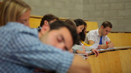 Student napping in the lecture hall