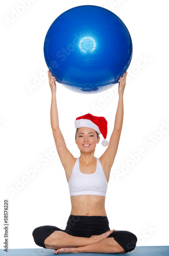 Athlete with the ball and hat of Santa Claus