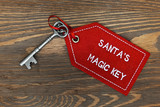 Santas magic key on a wooden background