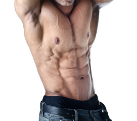 Bodybuilder with arms over his head showing torso