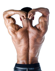 Bodybuilder with arms over his head showing shoulders and arms