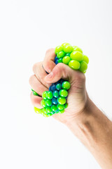 Male hand squeezing stress ball