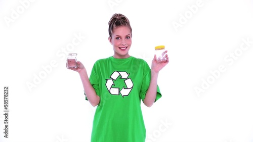 Cheerful female environmental activist showing two jam jars