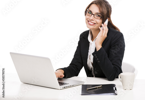 Businesswoman answering phone