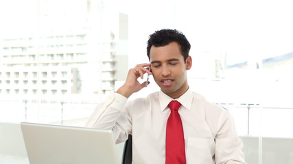 Successful handsome businessman phoning