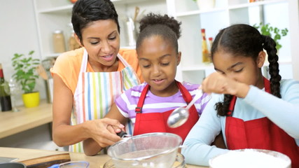 Ethnic Mom Cake Baking Young Daughters