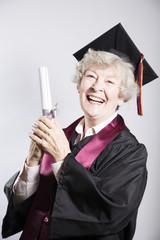 Elderly woman graduate holding degree