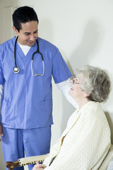 Male nurse assisting elderly patient