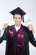 Smiling male graduate holding up diploma