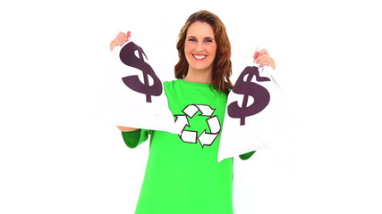 Smiling environmental activist showing money bags