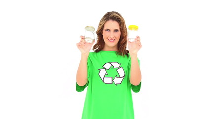 Smiling environmental activist showing jars