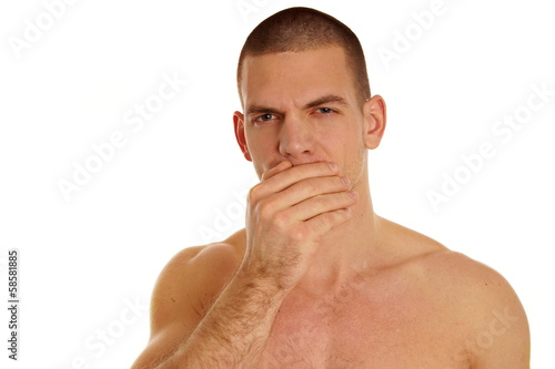 Coughing sick shirtless young man on a white background.