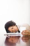 young african american woman sleeping on computer