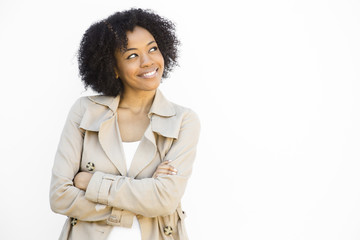 smiling woman against a white background looking away