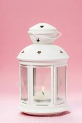 White lantern on pink background