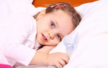 Little girl resting after treatment with aerosol