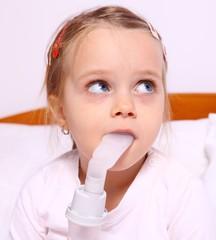 Girl during treatment for respiratory aerosols