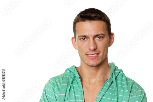Portrait of young man at green sweatshirt