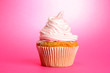 tasty cupcake, on pink background