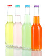 Drinks in glass bottles isolated on white