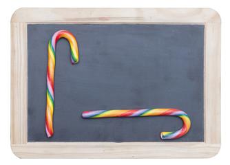 Sweet sugar candies on small blackboard