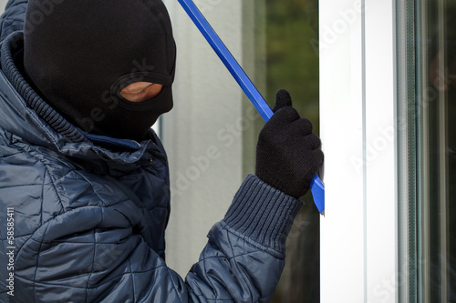 Housebreaker openning the window