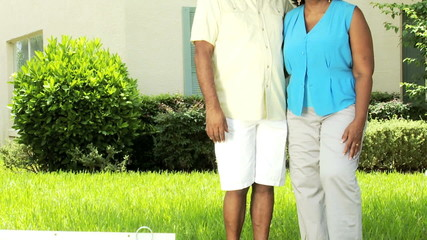 Senior African American Couple Outside New Home