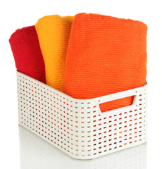 Plastic basket with towels  isolated on white