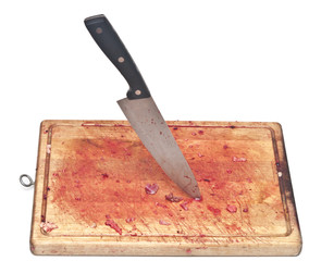 bloody and knife on the cutting board