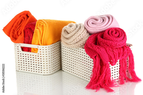 Plastic baskets with things isolated on white