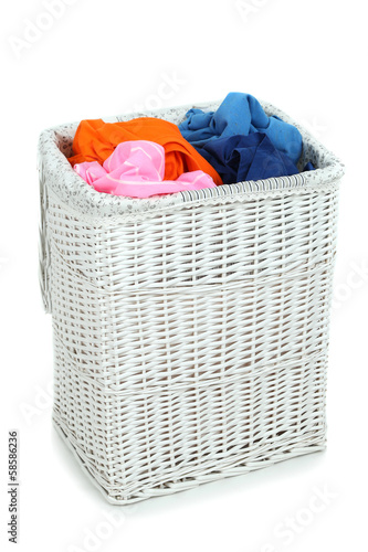 Full laundry basket isolated on white