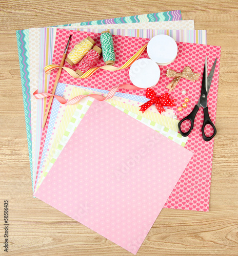 Paper for scrapbooking and tools, on wooden table