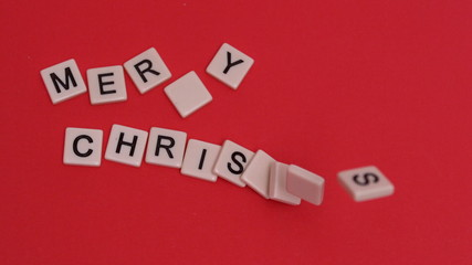 Letter tiles moving to spell out merry christmas