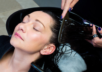 woman get hair washing and combing