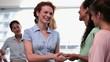 Businesswomen shaking hands after a seminar