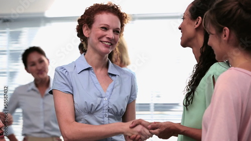 Businesswomen shaking hands after a seminar