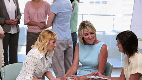 Businesswomen standing and chatting after a seminar