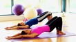 Toned women doing sports exercise lying on exercise mats