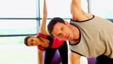Two sporty friend stretching their bodies
