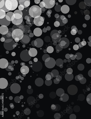 Transparent monochromatic bokeh balls on a black background