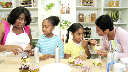 Three Generations Ethnic Females Kitchen Baking