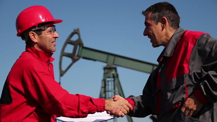 Two Oil and Gas Engineers Shaking Hands.