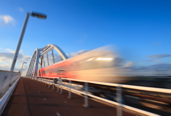 Train speeding over a bridge