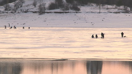 People fishing on a frozen lake