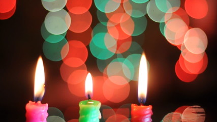 burning candle on bokeh background