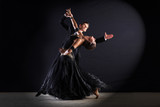 Fototapety Latino dancers in ballroom isolated on black