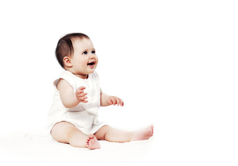 Cute happy baby on the floor on a white background