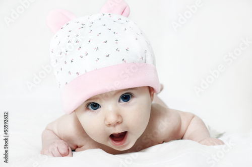 Portrait of a cute little girl isolated on white background