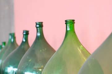 Old green bottles for wine making.