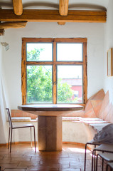 Empty room with wooden window and stone table